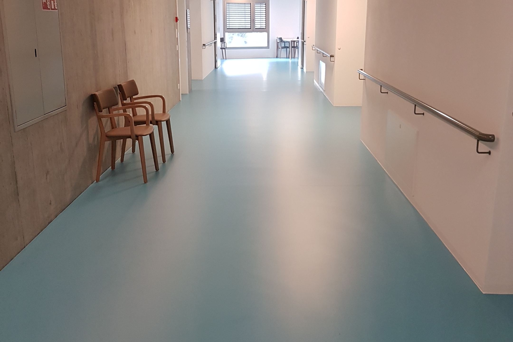 Sika ComfortFloor® blue floor in hospital hallway in Switzerland